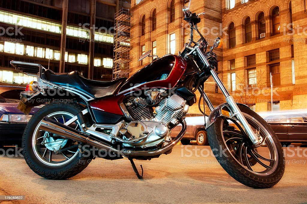 An urban rider motorcycle in a city at night stock photo