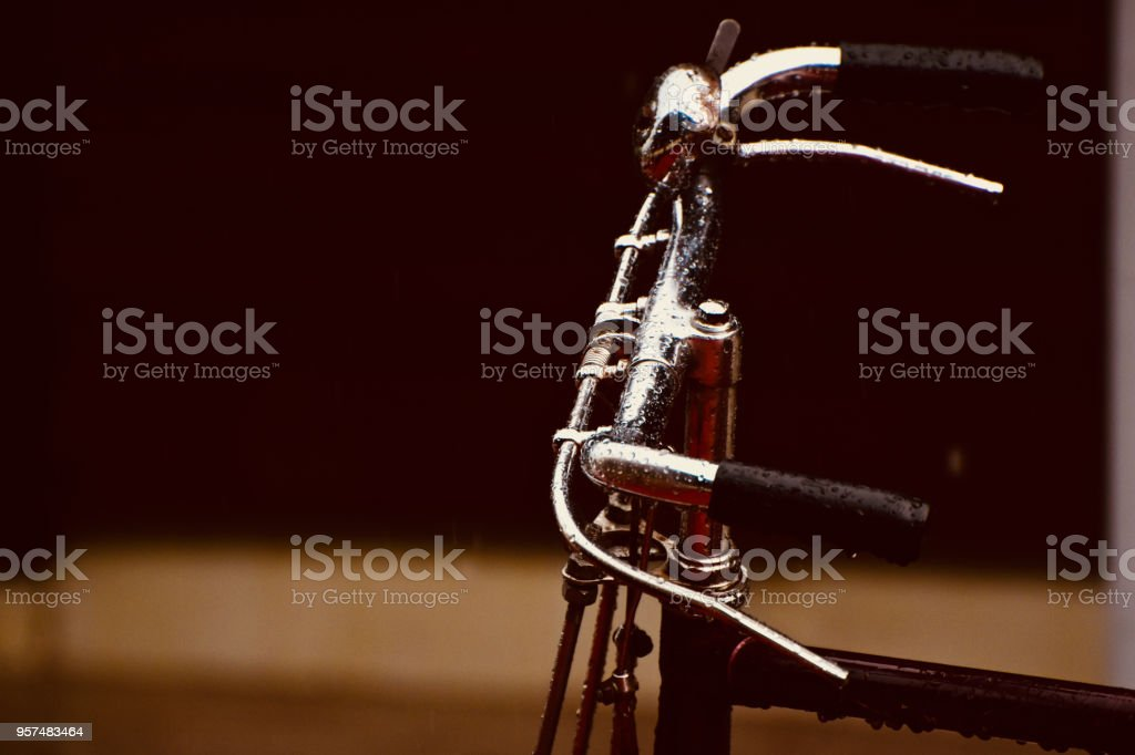 An wet bicycle's handlebar isolated unique photo royalty-free stock photo