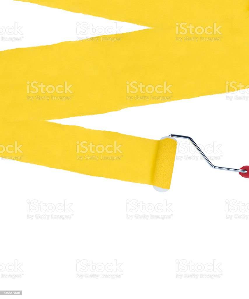 An xl plaint roller with yellow paint stock photo