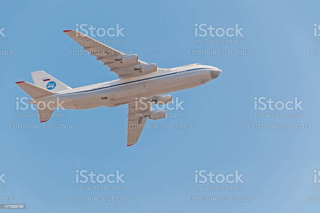 An-124 Ruslan cargo aircraft flies against sky background royalty-free stock photo