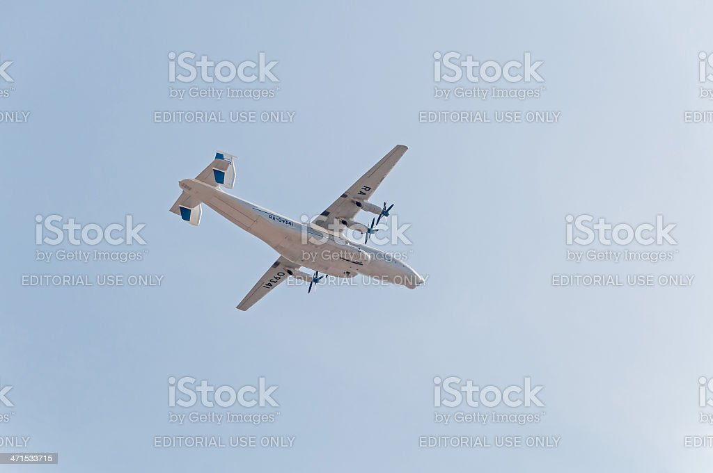 An-22 Antei largest turboprop-powered aircraft flies against blue sky background royalty-free stock photo