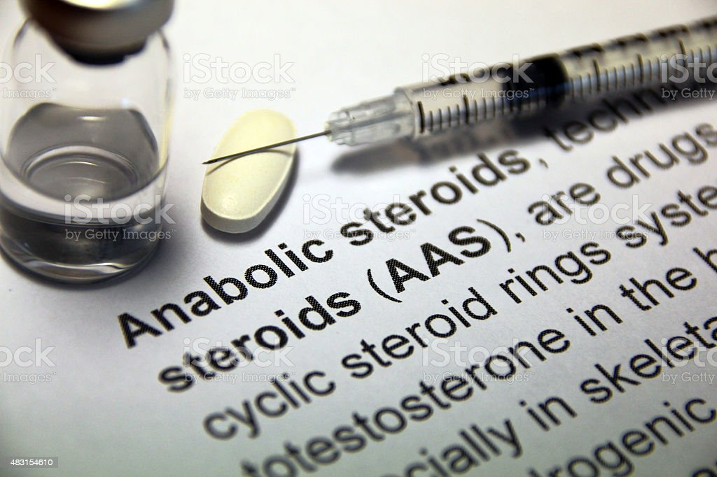 Anabolic steroid pill and syringe stock photo