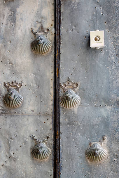anachronism Baroque door decorated with metal shells. An electrical stamp contrasts strongly with them anachronistic stock pictures, royalty-free photos & images