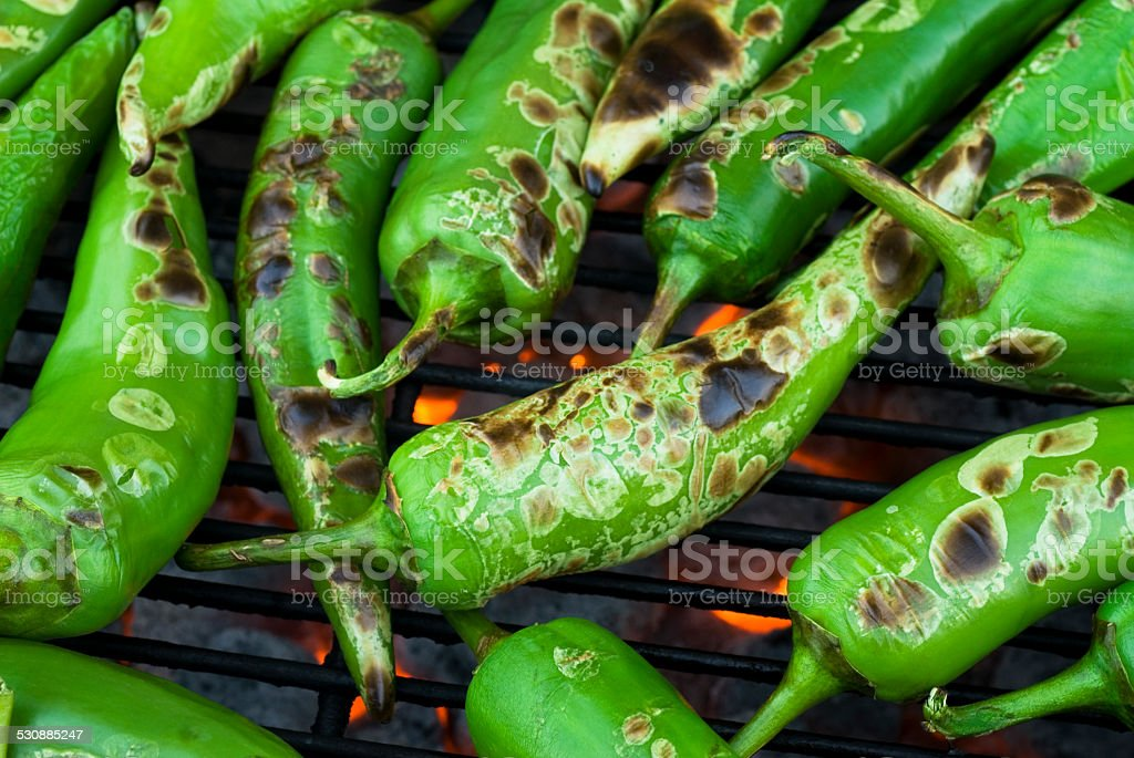 anaheim chilis roasting and blistered stock photo