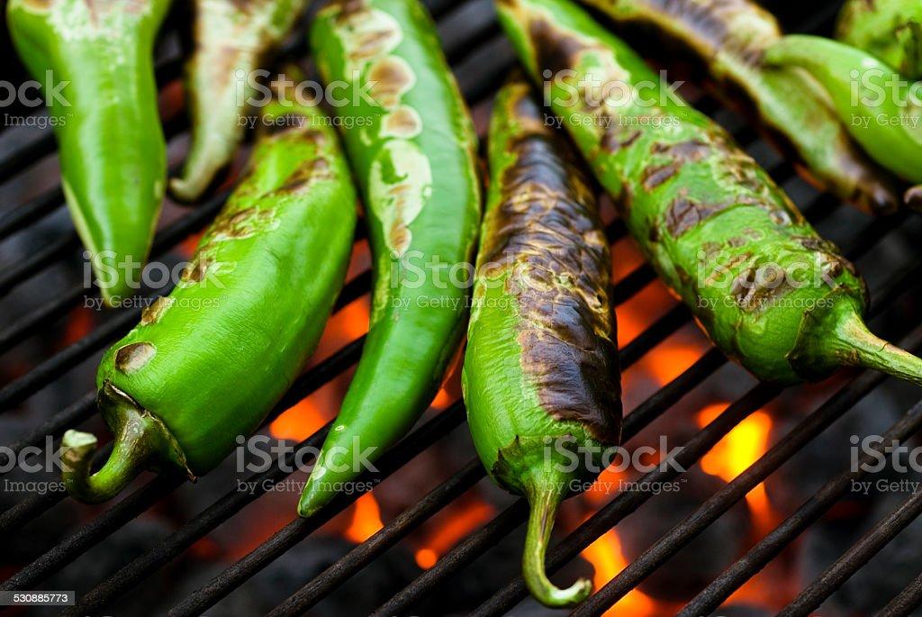anaheim chilis roasting macro stock photo