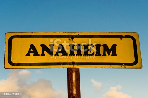 Anaheim city street old antique yellow sign with blue sky at background, USA signal city series.
