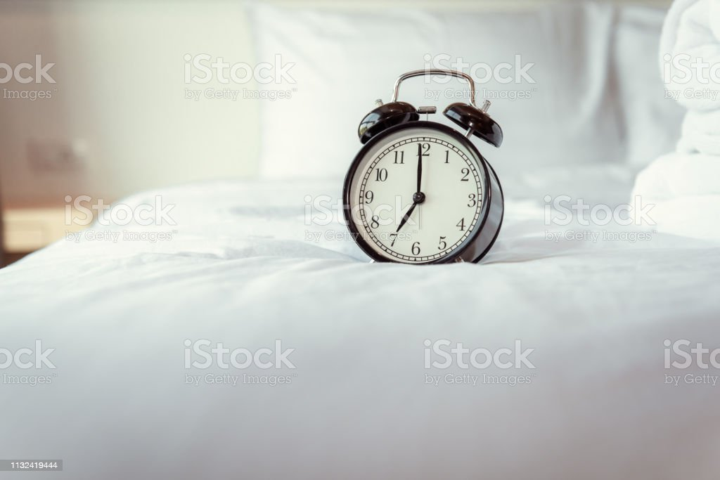 Analog Alarm Clock On Bedroom In Modern House Retro Timer At 700 Am On White Cover Bed Stock Photo Download Image Now