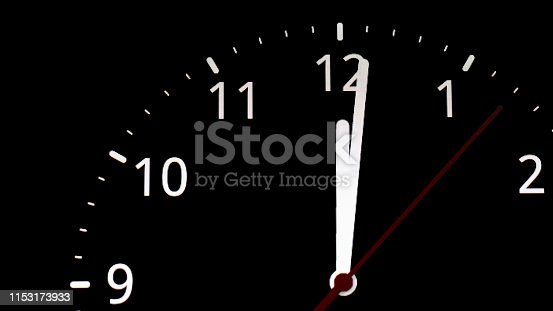 istock analog clock. clock about to 12 midnight or midday, conceptual of New Year and countdown. isolated on black background 1153173933