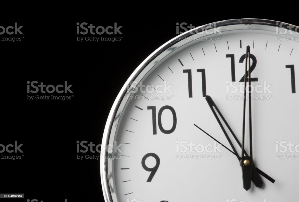 Analog clock with the time 11 o'clock stock photo
