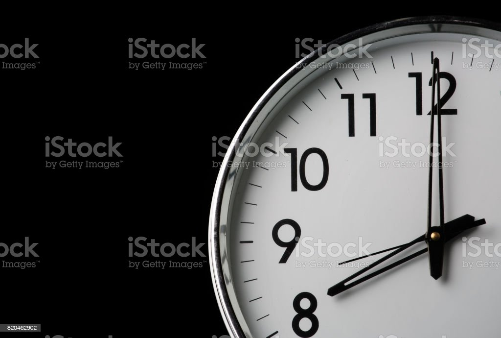 Analog clock with the time 8 o'clock stock photo