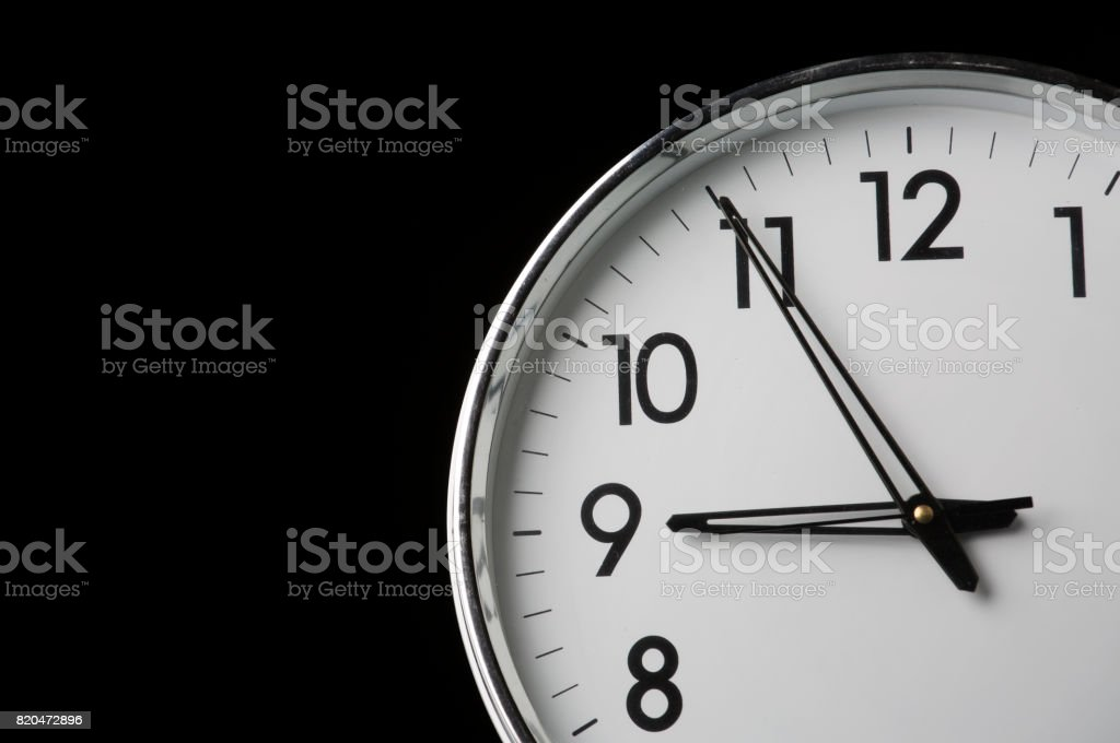Analog clock with the time 8:55 stock photo