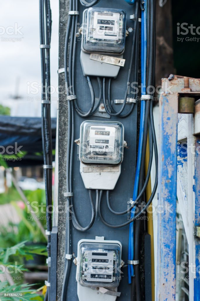 Analog electric meter Installed on the power poles. stock photo