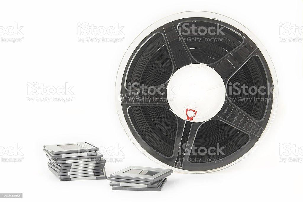 Analog film slides and movie reel royalty-free stock photo