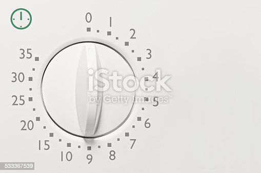 Analog microwave oven 35 minute timer, analogue vintage white dial face macro closeup, detailed grey numbers, green icon, large horizontal background copy space
