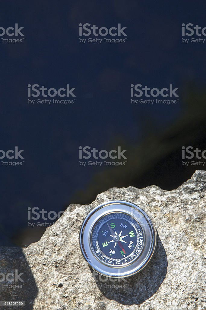 Analogic Compass Abandoned on the stone stock photo