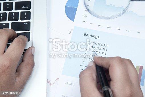 905049450 istock photo Analysing business reports 472310698