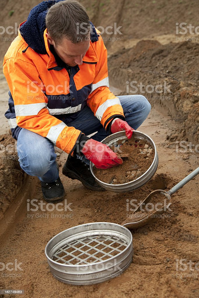 Analysing the soil, archeologist and environmetal research. stock photo