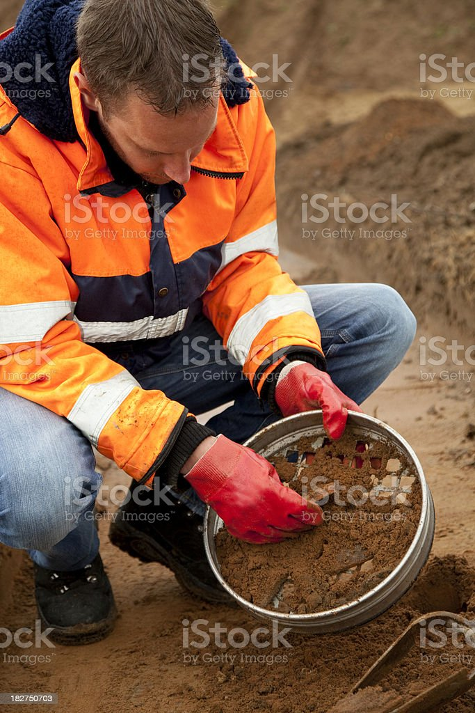 Analysing the soil, archeologist and environmetal research. royalty-free stock photo