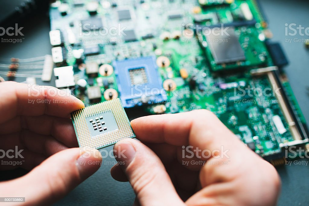 Analysis (installing) of processor in CPU socket stock photo