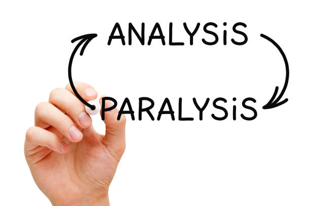 Analysis Paralysis Arrows Concept Hand drawing Analysis Paralysis overthinking concept with black marker on transparent glass board. paralysis stock pictures, royalty-free photos & images