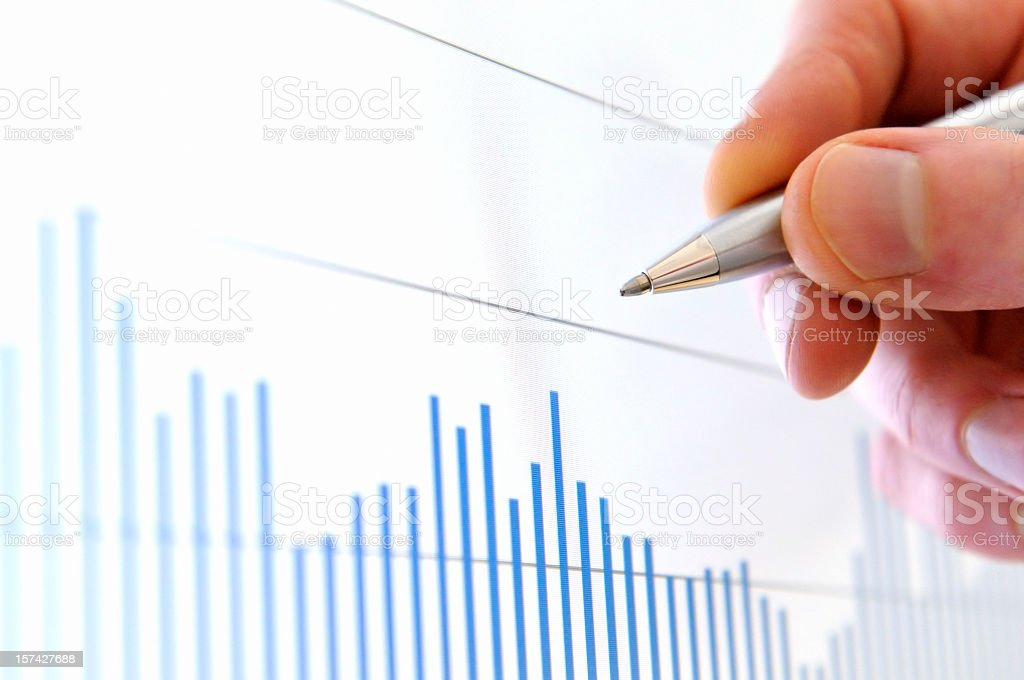 Analysis situation on stock exchange, hand pointing value on screen royalty-free stock photo