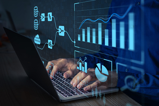 Analyst working with Business Analytics and Data Management System on computer to make report with KPI and metrics connected to database. Corporate strategy for finance, operations, sales, marketing