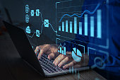 istock Analyst working with Business Analytics and Data Management System on computer to make report with KPI and metrics connected to database. Corporate strategy for finance, operations, sales, marketing 1286642964