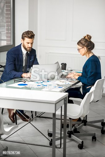 istock Analytic managers team working at the office 897528736