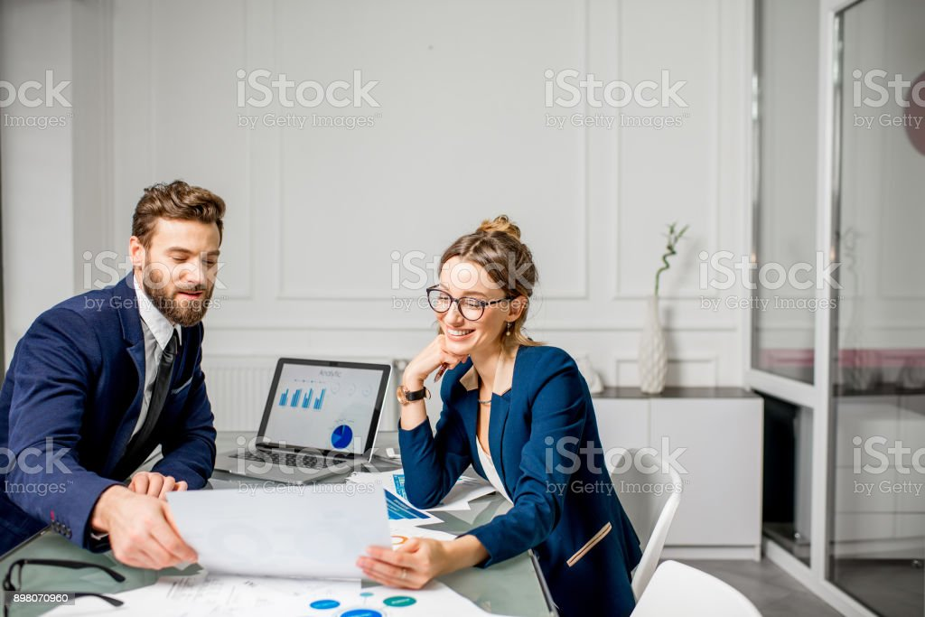Analytic managers team working at the office stock photo