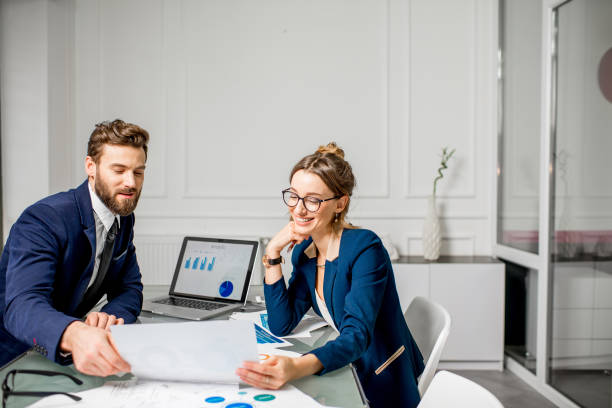 analytic managers team working at the office - accountancy stock photos and pictures