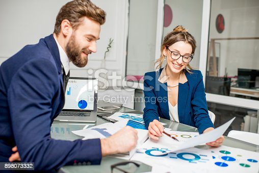 istock Analytic managers team working at the office 898073332