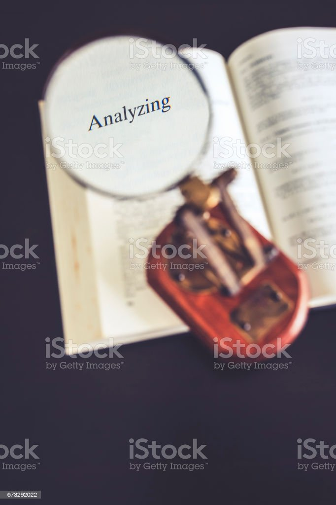 Analyze conceptual Magnifying glass on Book Reading Research royalty-free stock photo