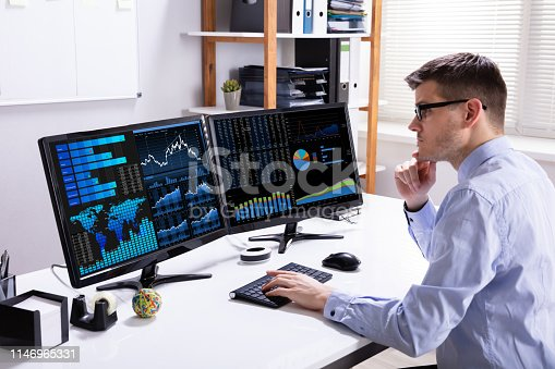 istock Analyzer Examining Graph On Computer 1146965331