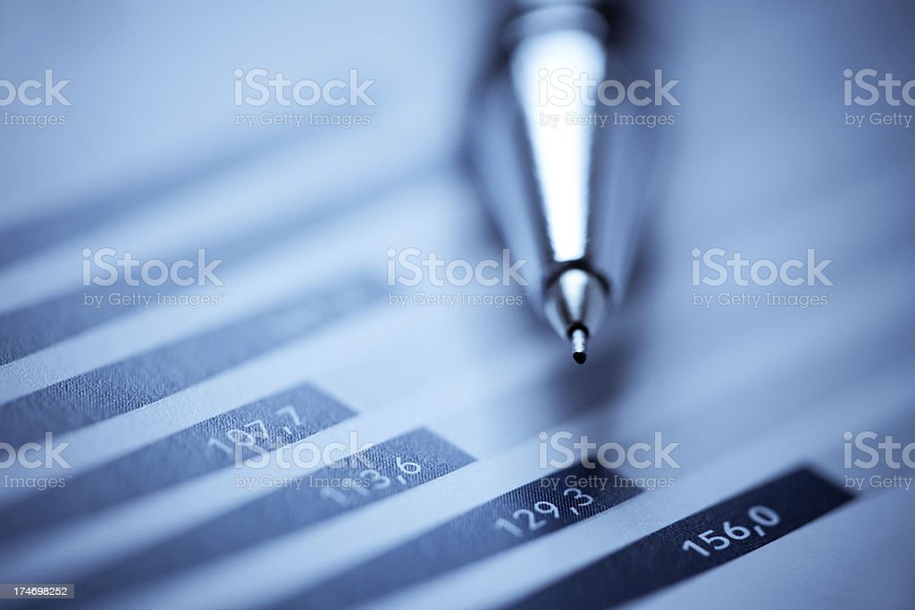 analyzing a financial report royalty-free stock photo
