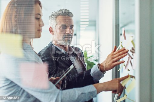 istock Analyzing business strategy 637884654