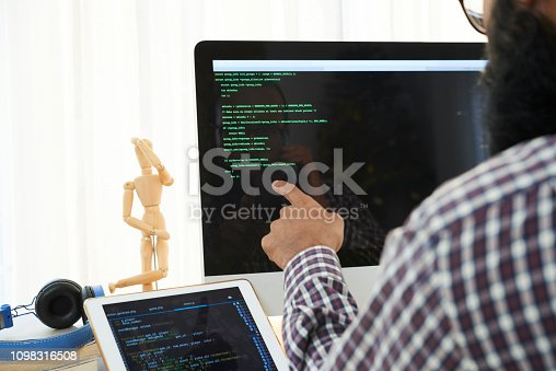 1088363766 istock photo Analyzing code 1098316508