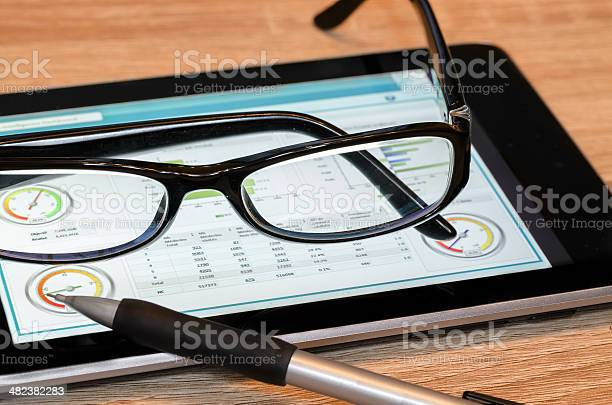 Analyzing Data On Tabletpc Stock Photo - Download Image Now