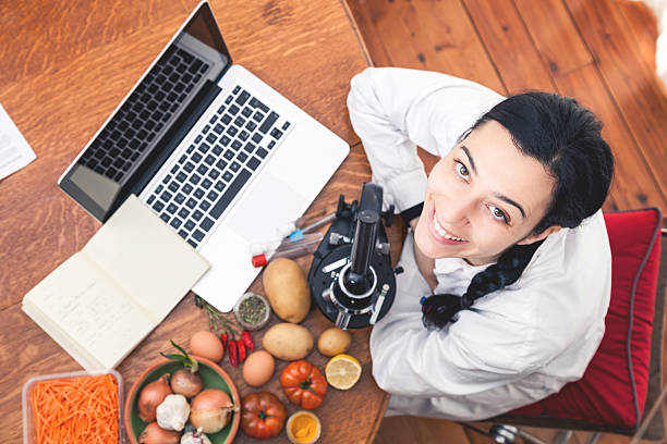 analyzing food - nutritionist stock photos and pictures