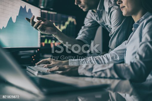 istock Analyzing graphs and reports for investment purposes. Creative teamwork traders. 821825672