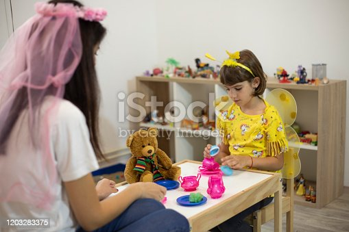 istock Analyzing Her Way Of Playing 1203283375