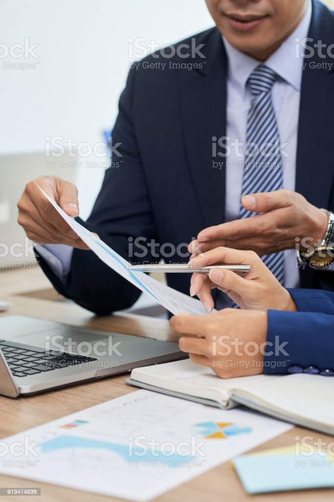 Analyzing reports stock photo