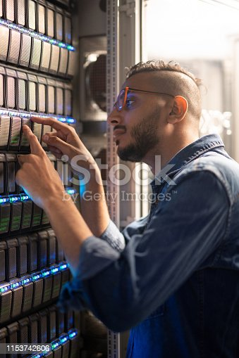 istock Analyzing sensors of server equipment 1153742606