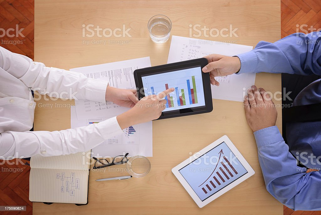 Analyzing with digital tablet royalty-free stock photo