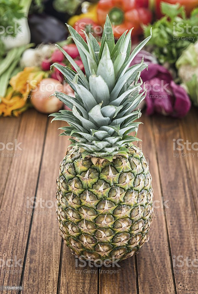 Ananas on wood plank with others vegeables royalty-free stock photo
