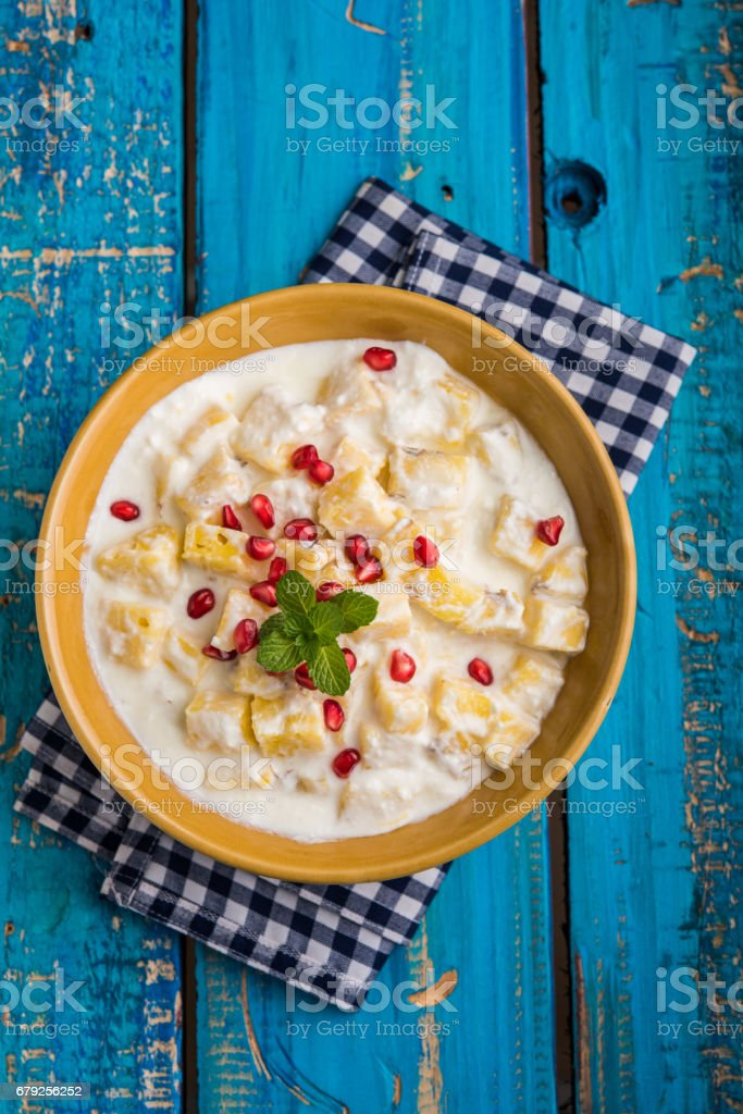 ananas or anaanaas or pineapple raita, chopped pieces of pineapple mixed with sweet curd and garnished with pomegranate and mint, favourite side dish or starter food in India photo libre de droits