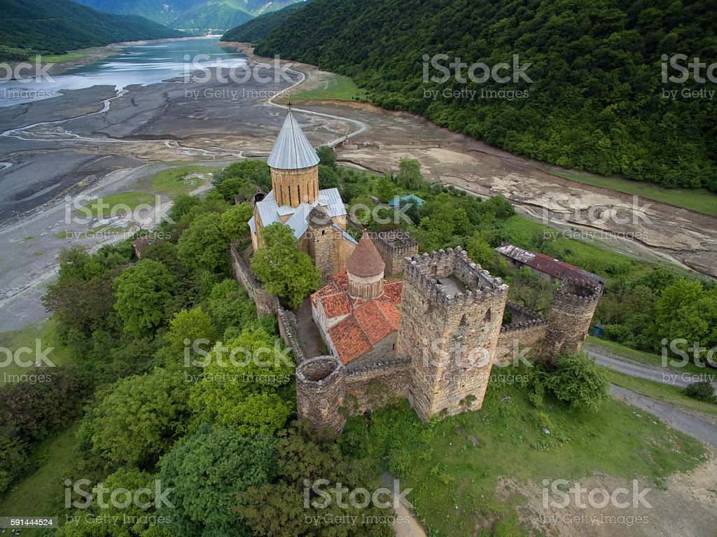 Ananuri fortress on a background of  dried river Aragvi stock photo