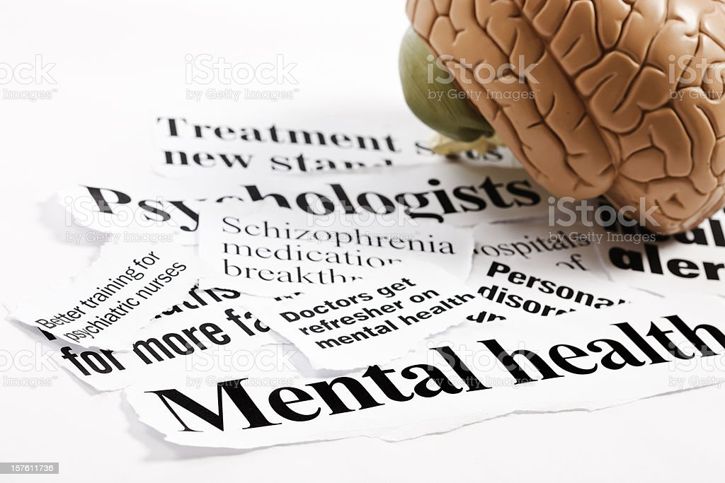 Anatomical model of human brain on mental health headlines royalty-free stock photo