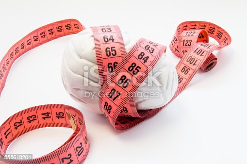 istock Anatomical shape of human brain wrapped measuring tape. Concept photo for visualizing measuring brain size, brain size and weight compared to efficiency of mental activity, intelligence and iq 855618204
