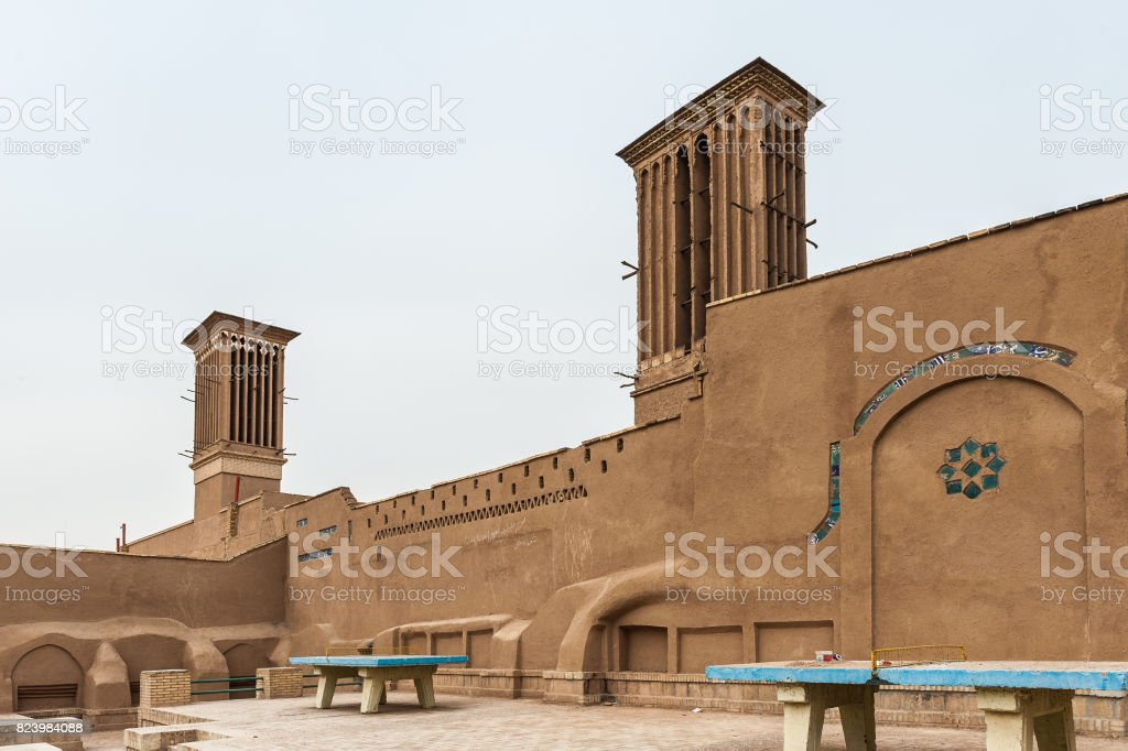 Anceint wind catchers located on the top of the buildings serving for cooling of the space stock photo