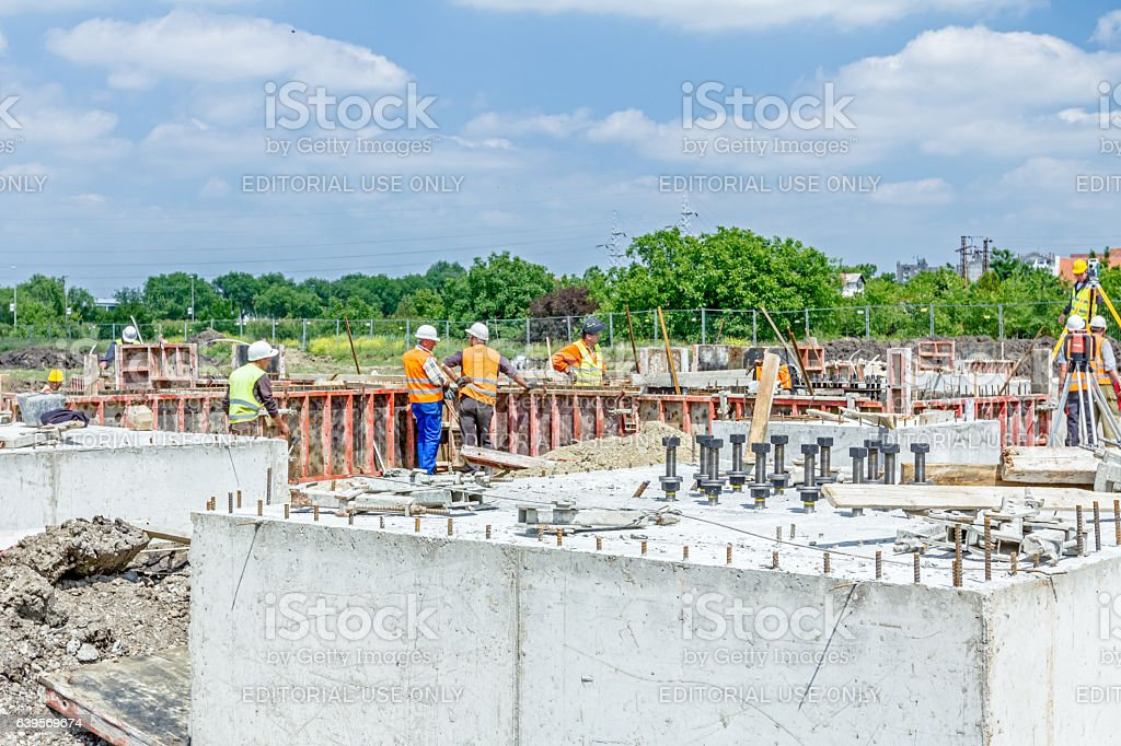 Anchor bolts in concrete base with reinforcement at building site. stock photo